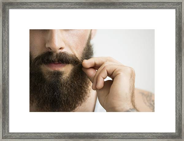Close Up Of Man Touching Mustache Framed Print by Hero Images