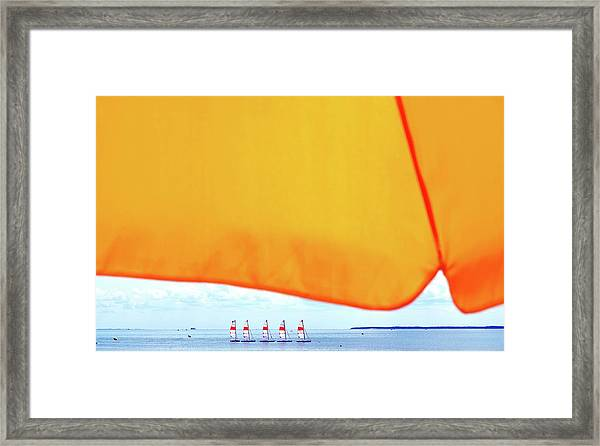 Close-up Of Parasol Against Boats On Sea Framed Print