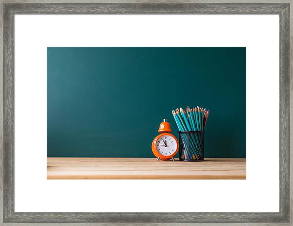 Close-up Of Pencils In Container By Alarm Clock On Table Framed Print by Shih Wei Wang / EyeEm