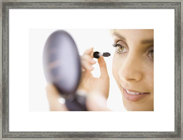 Close-up Of Woman Applying Makeup Framed Print by Jupiterimages, Brand X Pictures
