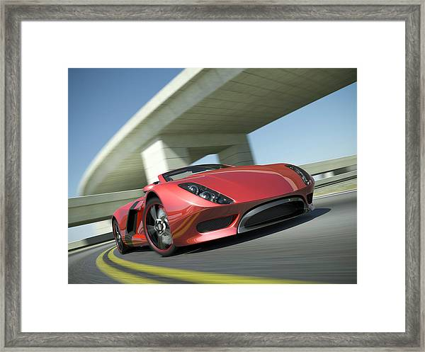 Closeup Of A Red Sports Car Driving Framed Print