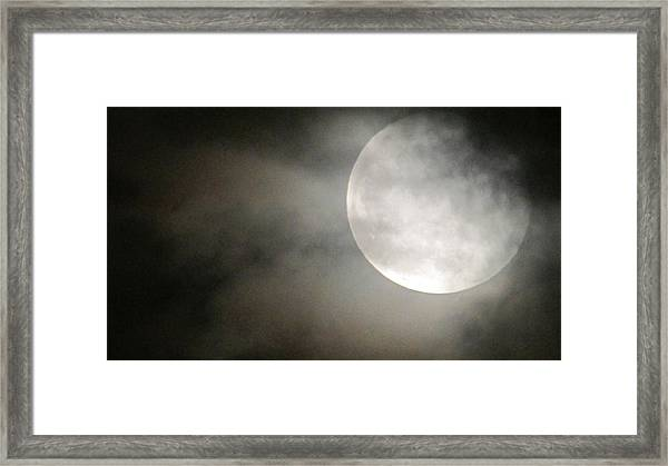 Clouded Moon Framed Print