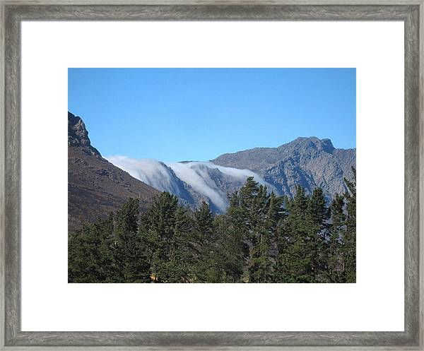 Clouds Flowing Over The Mountains Framed Print