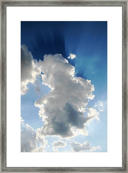 Clouds In The Sun Framed Print