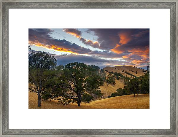 Clouds Over Black Diamond At Sunset Framed Print