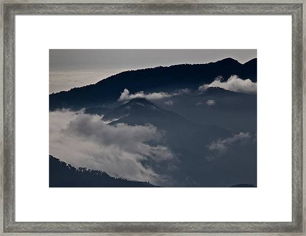 Clouds Over The Mounatins Framed Print by Brian Magnier