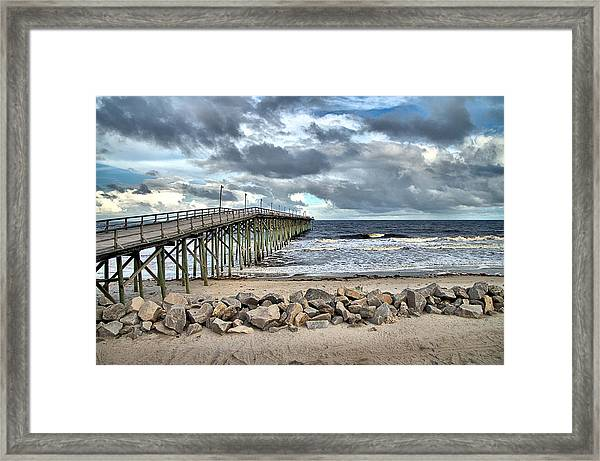 Clouds Over The Pier Framed Print