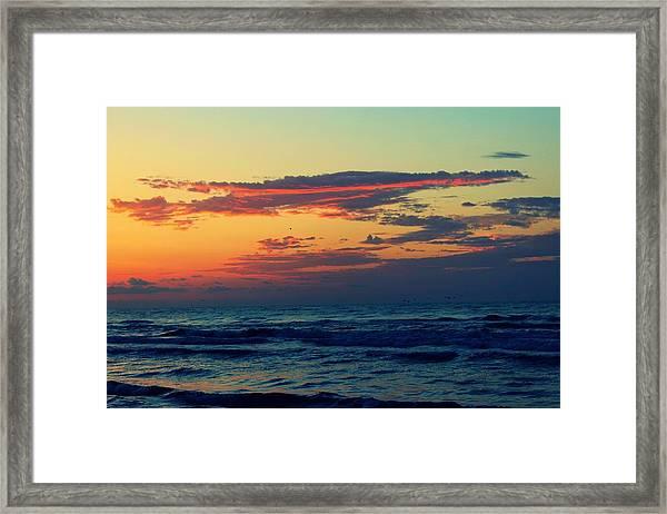 Cloudy Pink Ocean Framed Print