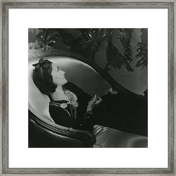 Coco Chanel On A Chaise Longue Framed Print