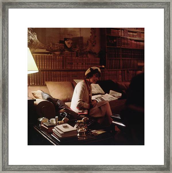 Coco Chanel Wearing A White Hat Framed Print