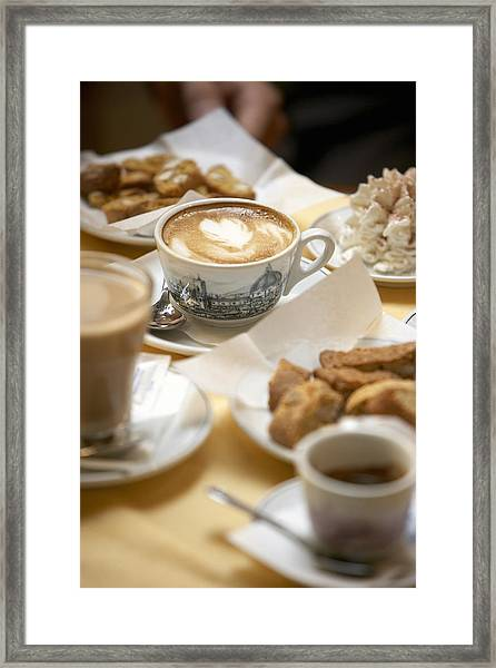 Coffee Drinks And Biscotti On Table In Cafe (focus On Cappuccino) Framed Print by Bob Handelman