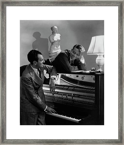 Cole Porter And Moss Hart At A Piano Framed Print