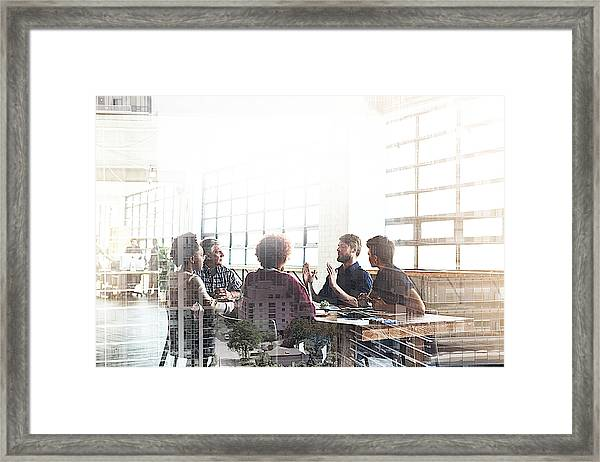 Collaborating To Build The City Of Their Dreams Framed Print by PeopleImages