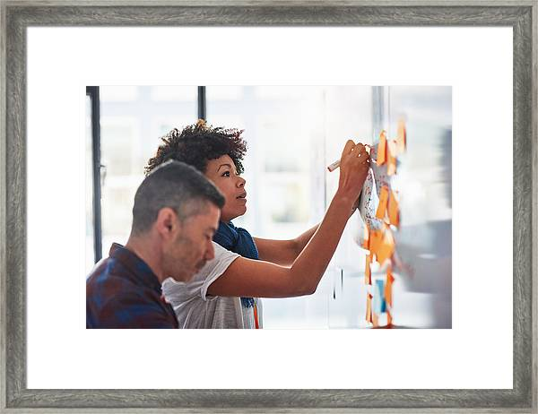 Colleagues Brainstorming In A Tech Start-up Office Framed Print by 10'000 Hours