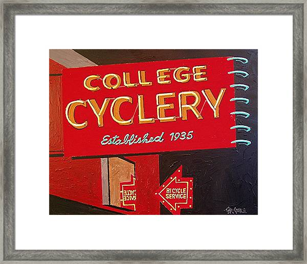 College Cyclery Framed Print by Paul Guyer