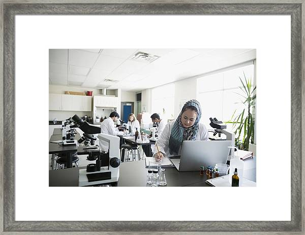College Student Wearing Hijab At Laptop In Science Laboratory Framed Print by Hero Images