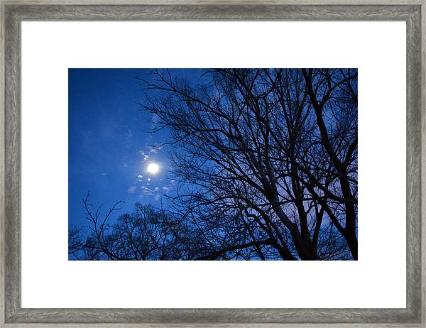 Colored Hues Of A Full Moon Framed Print by Bill Helman