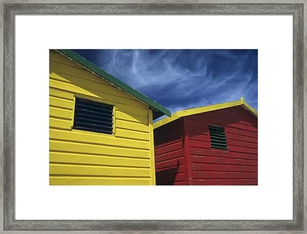 Coloured Beach Huts Framed Print