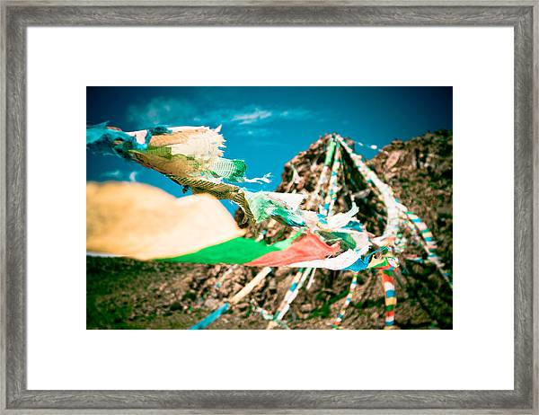 Framed Print featuring the photograph Colourfull Praying Buddhist Flags Lungta And Mountain At Background by Raimond Klavins