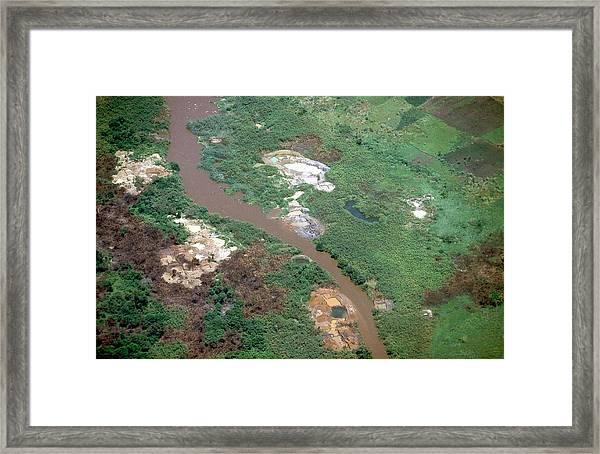 Coltan Ore Mining Framed Print