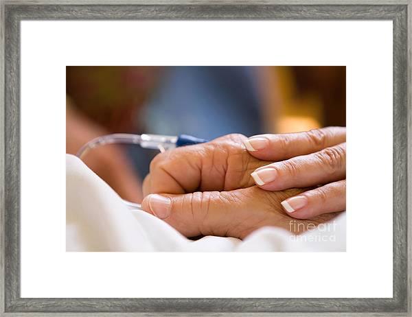 Comforting Hand Framed Print
