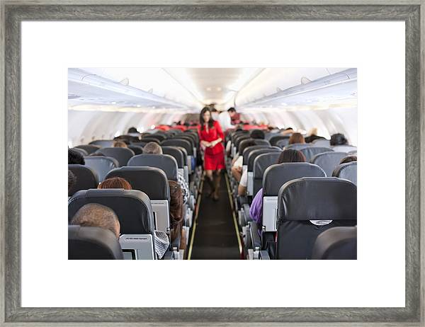Commercial Airliner Cabin. Framed Print by Enviromantic