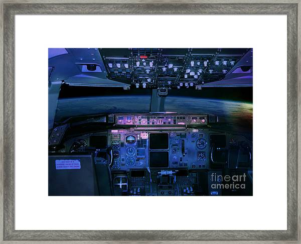 Commercial Airplane Cockpit By Night Framed Print