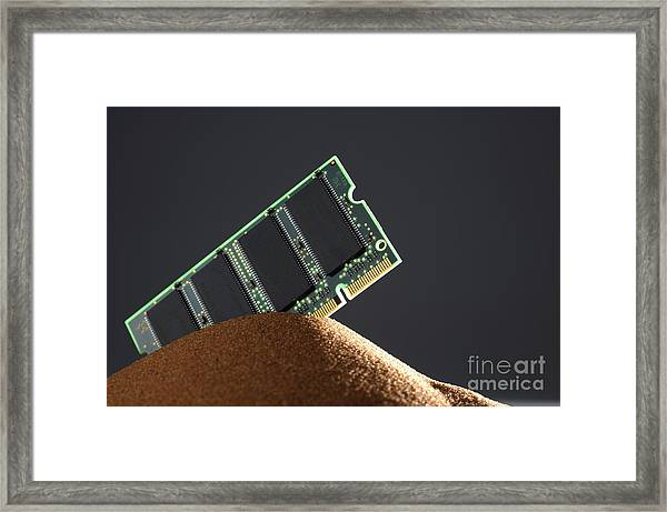 Computer Memory Chip On Red Sand Framed Print by Sami Sarkis