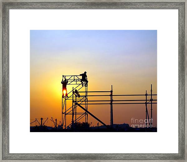 Construction Workers On A Scaffold Framed Print
