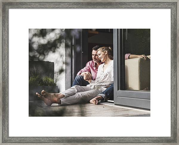 Content Mature Couple Relaxing Together At Open Terrace Door Framed Print by Westend61