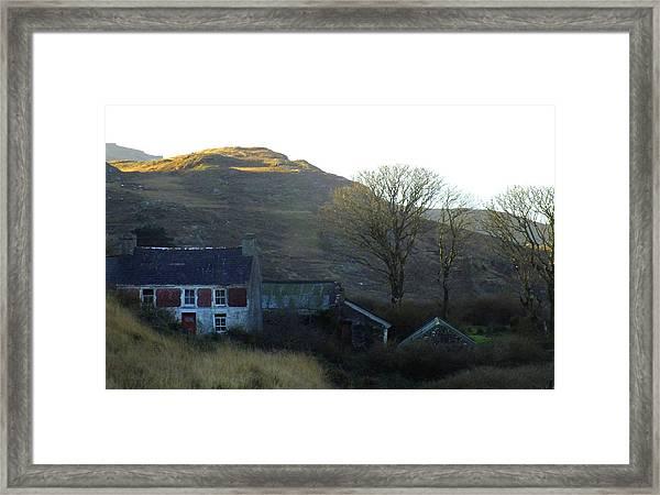 Cottage On Hillside Framed Print
