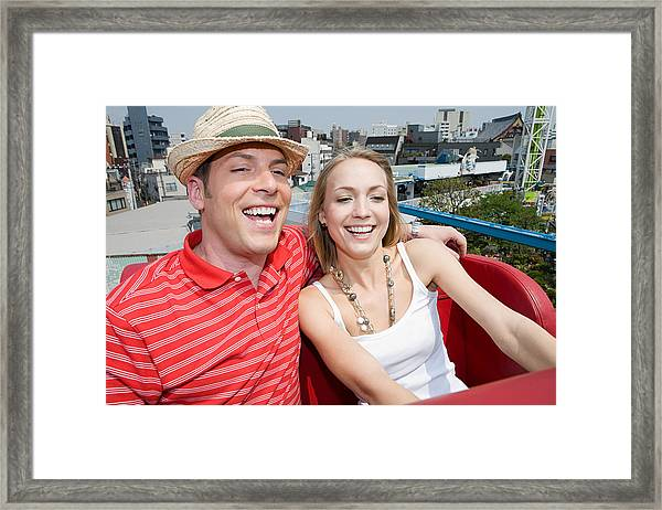 Couple At An Amusement Park Framed Print by Image Source