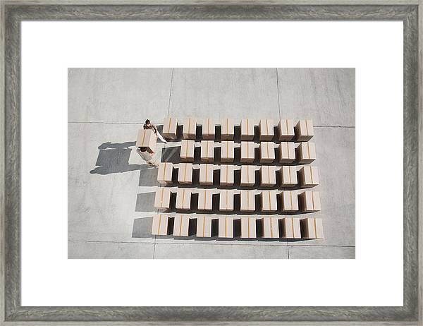 Couple Carrying Box Framed Print by Martin Barraud