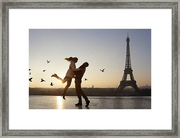 Couple Embracing, View Of Eiffel Tower Framed Print by Peter Cade
