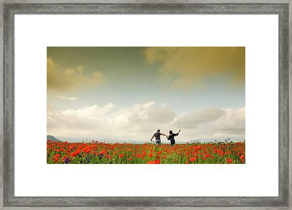 Couple Holding Hands Framed Print