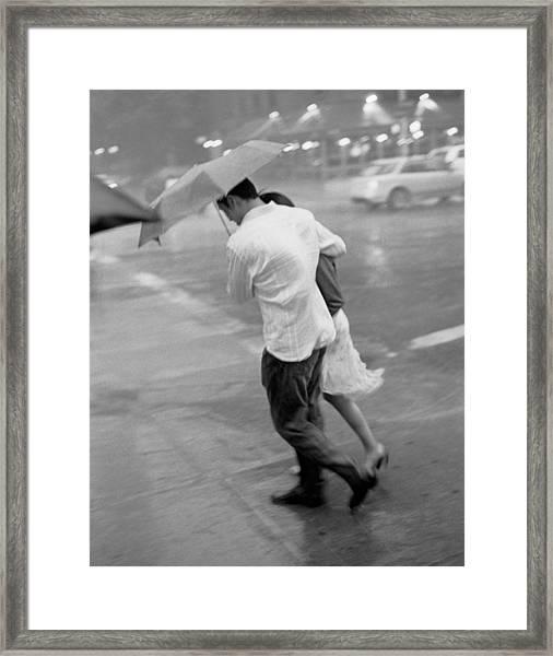 Couple In The Rain Framed Print
