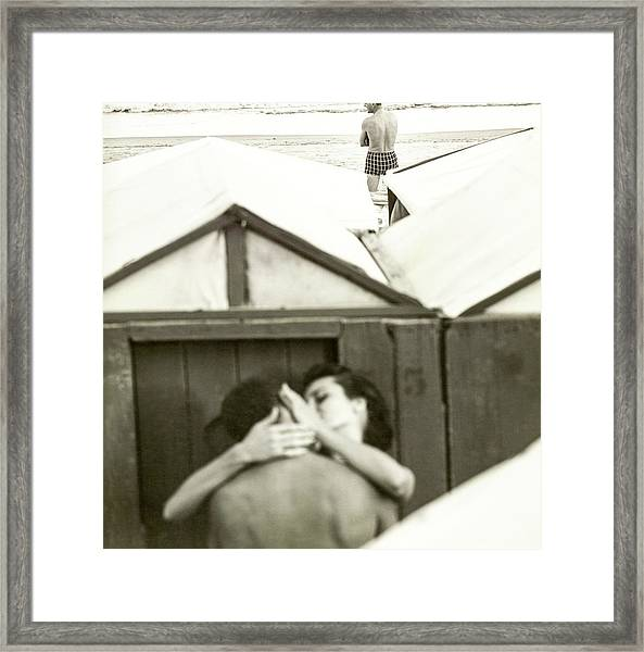 Couple Kissing By A Model Wearing Westwood Trunks Framed Print