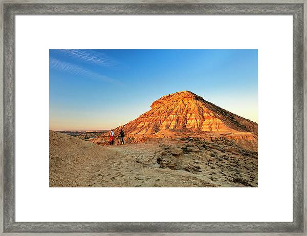 Couple Looking At Desert From Clay Framed Print by Simon Greenwood