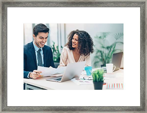 Couple Of Business Persons On A Meeting Framed Print by Pixelfit