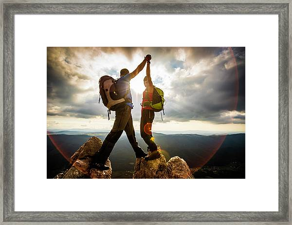 Couple On Top Of A Mountain Shaking Framed Print