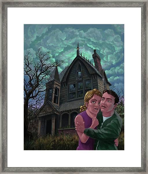 Couple Outside Haunted House Framed Print