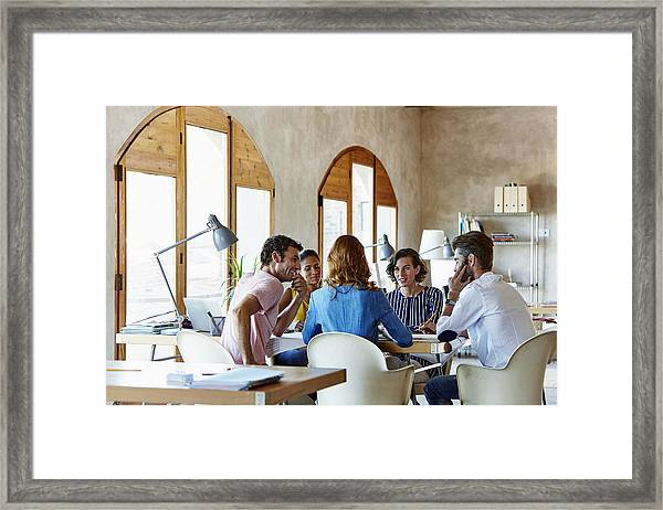 Creative Business People Discussing In Office Framed Print by Morsa Images