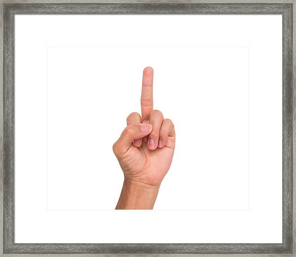 Cropped Image Of Person Showing Middle Finger Against White Background Framed Print by Wichai Treethidtaphat / EyeEm