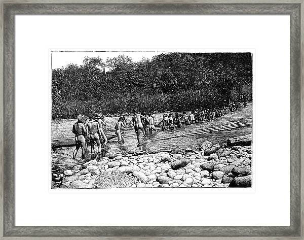 Crossing A River In Vietnam Framed Print by Science Photo Library