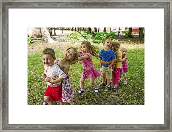 Cute Children Playing At Park Framed Print by UygarGeographic