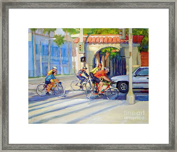 Cycling Past The Archway Framed Print