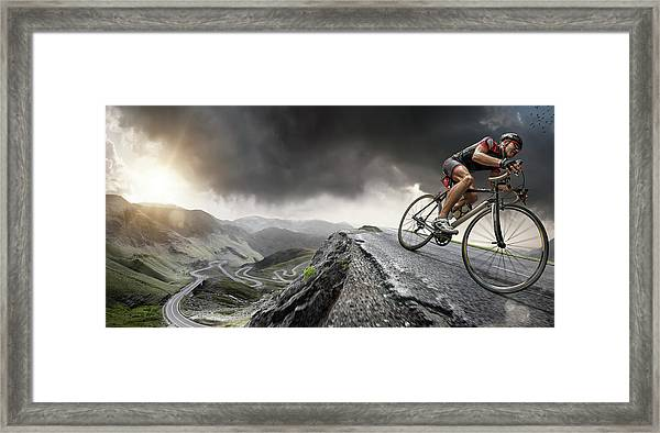 Cyclist Climbs To The Top Framed Print by Peepo