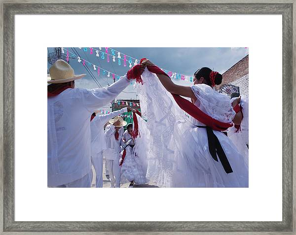 Dancers At A Traditional Fiesta Framed Print by Russell Monk