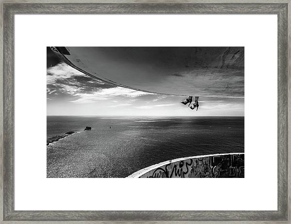 Dangling Shoes Framed Print by Burkhard Achtergarde
