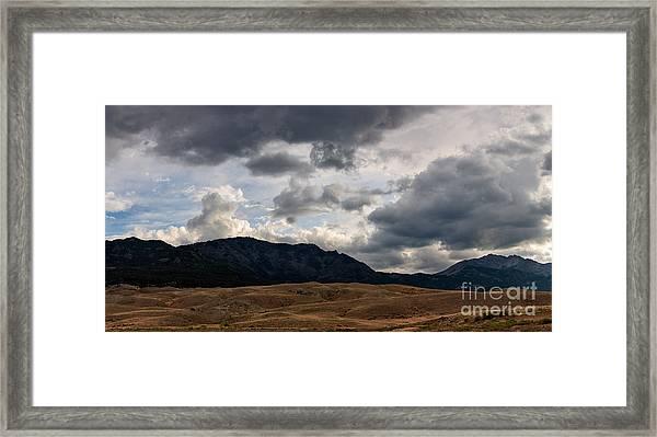 Dark Clouds On The Horizon Framed Print